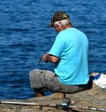 preparing the hook, Boca Do Inferno, Cascais, Portugal