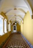 white door, yellow hallway