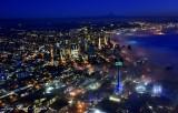 Seattle shows Seattle Seahawks Blue and Green Colors, Space Needle, 12th Fan, Shroud in Fog, Mt Rainier