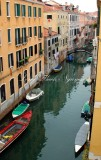 Boats in small canal in Venice, Italy 072