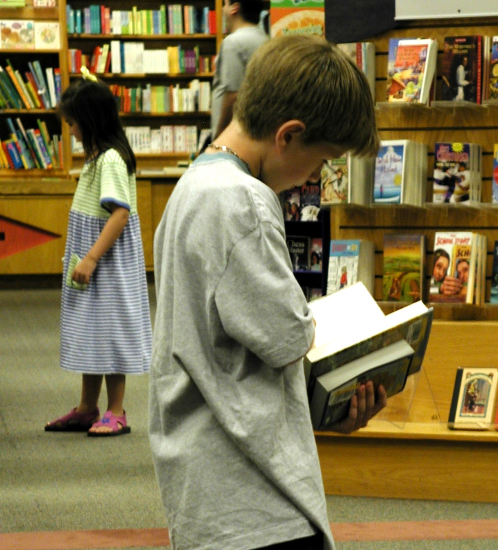 Heres a reader who can stand and read TWO books!