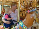 Kaelyn ridesa reindeer with granma