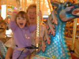Taya wavesfrom her dragon with granma