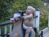 Kaelyn rides her horsie