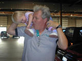 Granpa gives Kaelyna ride on his sholders