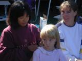 Tomoko braids Caitlin's hairwhile Petenia watches