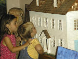 Girls Checking Out The Haunted Dollhouse