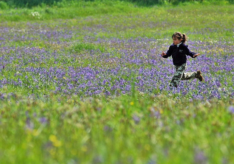 Girl Running in a Meadow