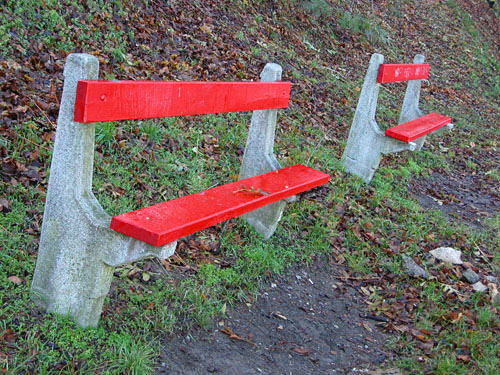 Bright red benches in Gellért Hill park