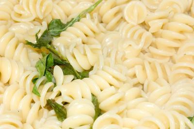 cooked rotini pasta with rau ram sprigs