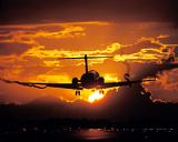 Continental Airlines DC9 landing sunset aviation stock photo #SS9502