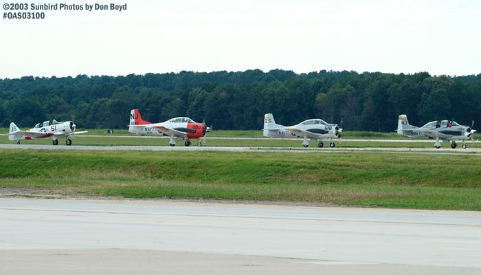 Four warbirds in takeoff position stock photo #6958