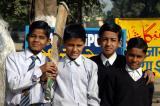 Schoolboys with a cricket bat