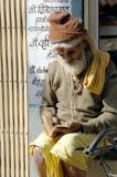 Old man reading a book, Gwalior, India