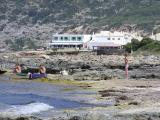 Es Calo Rockpools with the village in the background