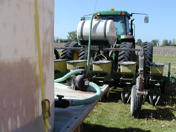 Filling the liquid fertilizer.JPG
