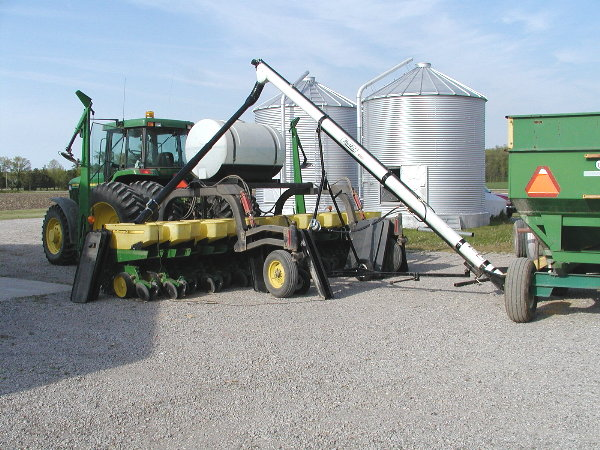 Filling the hoppers with soybean seed.JPG