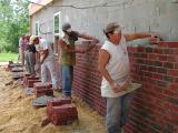 Bricklayers back to work on the outside  06/19/2002