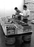 Stewards retrieve contestants' brews from the walk-in fridge at Old Dominion Brewing Co....