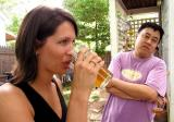 Jessica Parker samples a homebrew while Jeff Chan looks on