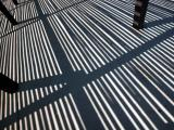 Abstract - shadows from a slatted open structure