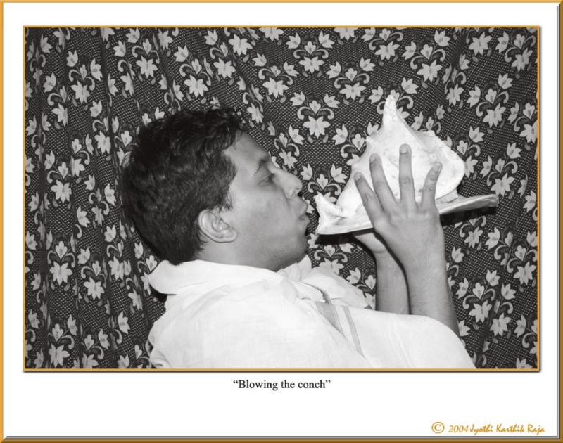 12.31.04 - Blowing the conch