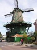 Bicycle behind windmill