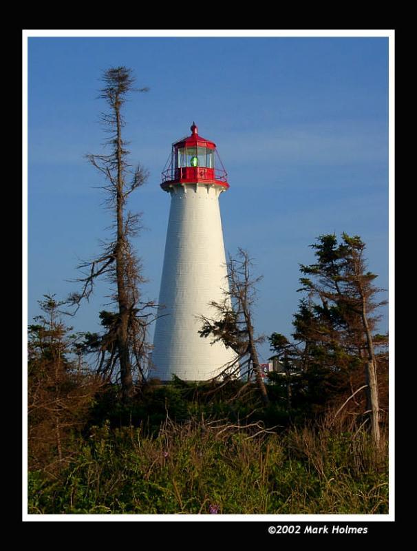 Afternoon sun striking Point Prim lighthouse on PEI