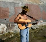 Guitarist Playing To The Ocean