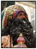 An ancient king or holy man bears gifts. This is the basis for modern traditions of giftgiving.