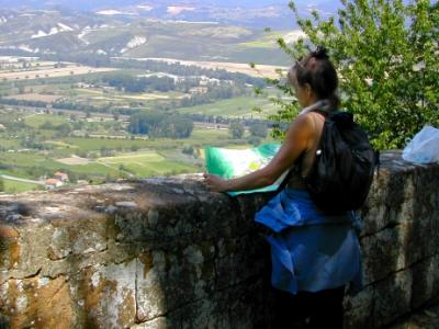 Judy on Viale Carducci in Orvieto with Umbrian countryside in background