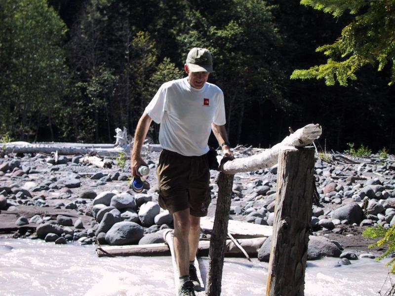 Ron crossing White River - one of many log crossings.