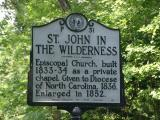 Sign on US 25 noting the history of the church, visible from these garden sites.
