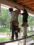 Carpenters work on the front porch trim