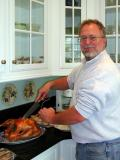 Mike carves the turkey