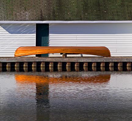 Canoe Beside Boathouse