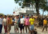 tsunami survivors in front of mosque