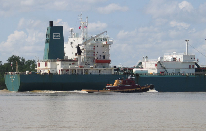 Ship and Tugboat in Mississippi River