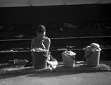 russian boy selling bread at train station