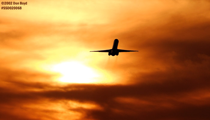 MD80 takeoff sunset aviation stock photo