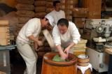 Preparing Yomogimochi (steamed rice paste mixed with the yomogi herb).