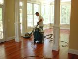 The floor receives a buffing between finish coats