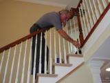 Coel applies stain to the stair treads