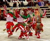 Dance of the Cremation Grounds,  an important thread in Tibetan Buddhist Wisdom, teaching impermanence in all aspects of life, including the mind, 5 skulls on top of the mask, rainbow colored fans on their ears. The actors are also called citti patti or tur tu tak ba.