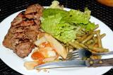 strip steak, greek potatoes, garlic mint beans, salad