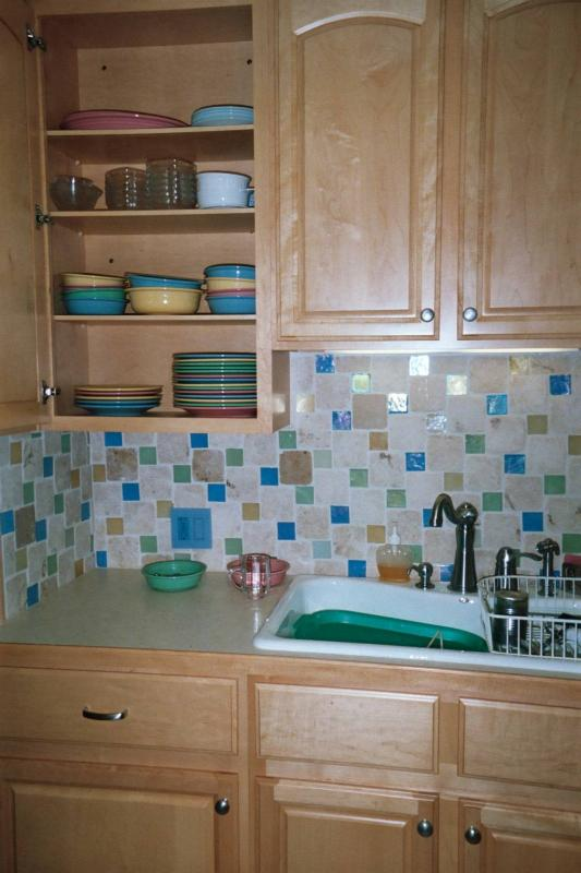 The reason we did a pastel backsplash... pastel Fiestaware and bad habits that have them sitting out a lot.