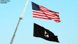 American and POW-MIA flags air show stock photo