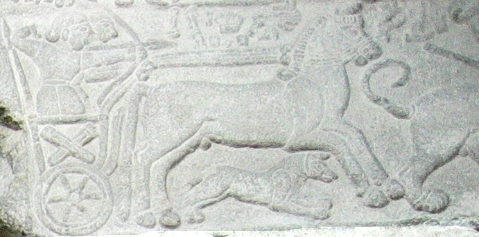 The little chariot scene placed above the large stone