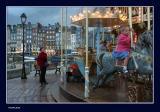 Enjoying Honfleur merry-go-round