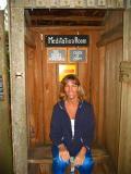 sitting on the toilet   (kodak moment)